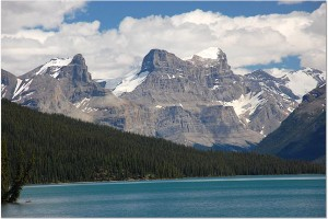 mountains with blue lake and white clouds